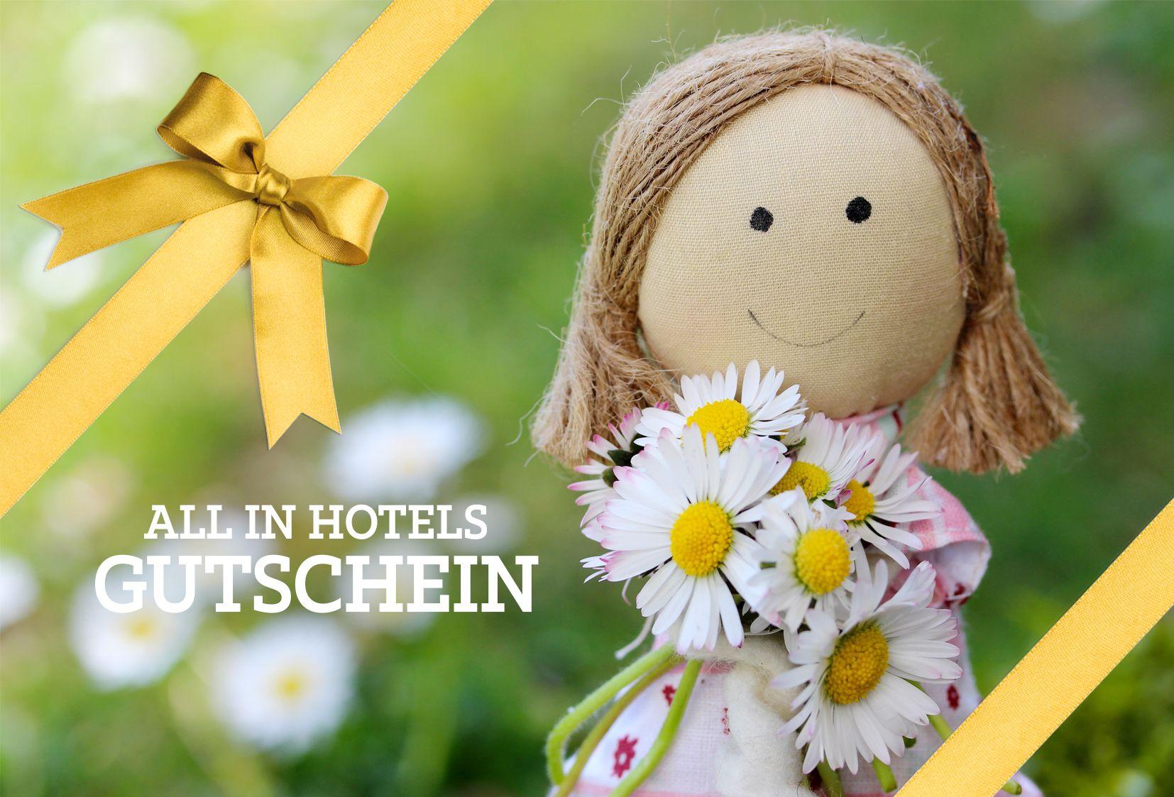 ALL IN Hotels Gutschein Foto Puppe mit Blumen, Schleife ...
